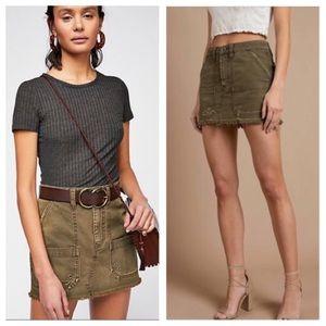 Free People distressed olive cargo mini skirt